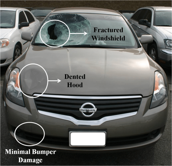 grey Nissan car damage